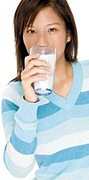 Woman drinking glass of milk. - Copyright – Stock Photo / Register Mark