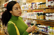 Woman shopping for supplements. - Copyright – Stock Photo / Register Mark