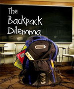 Backpack stuffed full of school supplies in classroom. - Copyright – Stock Photo / Register Mark