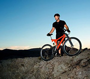 Athlete standing with mountain bike. - Copyright – Stock Photo / Register Mark