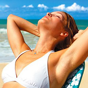 Woman sunbathing. - Copyright – Stock Photo / Register Mark