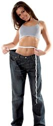 Woman wearing overly large pants to illustrate how much weight she has lost. - Copyright – Stock Photo / Register Mark